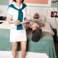 Asian 60+ MILF Kim Anh giving handjob to large cock in hospital