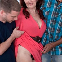 Sixty plus MILF with red hair tangles with black and white men at the same time