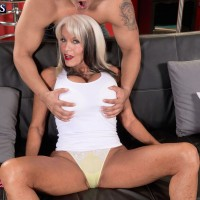 Buxom mature babe Sally D'Angelo having her huge granny boobs freed from bra