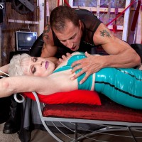 60+ MILF in latex and stockings having tits and nipples sucked on bondage table