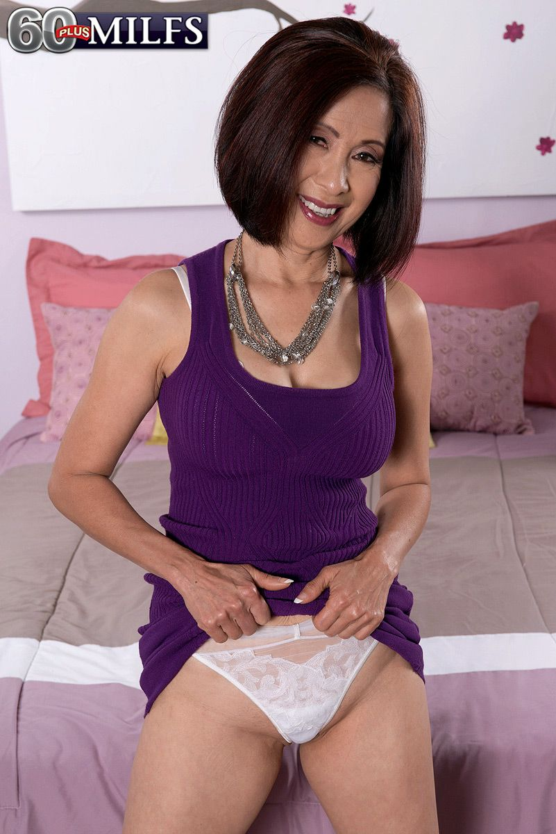 Tiny Oriental granny in high heels gets atop young stud and pinches his nipples