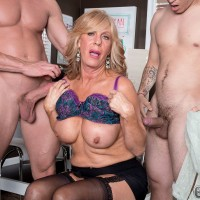 Tall granny with blonde hair and nice tits seduces a couple of boys at once