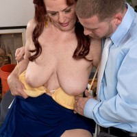 Mature MILF Katherine Merlot letting big saggy tits loose for fondling by man