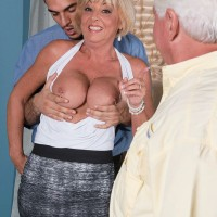 60+ MILF with blonde hair fucks a younger man in front of her older husband