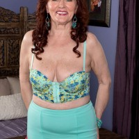 Mature redhead Katherine Merlot undresses to fuck younger man