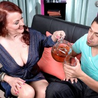Redheaded granny exposes her boobs while seducing a younger man