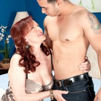 Stocking clad aged redhead Katherine Merlot freeing big tits from lingerie before bj