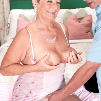 Busty over 60 granny Joanne Price unleashing big boobs before giving blowjob
