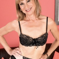 Tall blonde nan models a sensual lingerie ensemble paired with sheer stockings