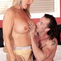 Pantyhose and garter clad 60plusmilf.com model Phoenix Skye having tits licked