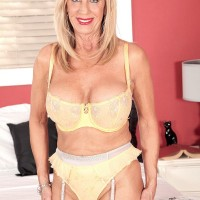 Pantyhose and garter clad 60plusmilf.com model Phoenix Skye having tits licked