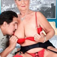 Horny granny with short hair seduces her younger lover in bra and panties with nylons