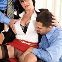Busty mature brunette woman Rita Daniels fucks two cocks in MMF threesome