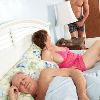 Short haired 60 MILF has sex with a boy while her husband looks on