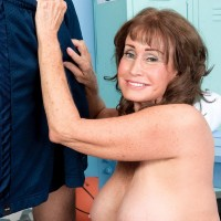 Sexy 60 plus MILF seduces the much younger locker room attendant in shorts
