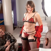 60 MILF model attracts a black man and her photographer in skimpy lingerie