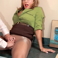 Glasses and skirt attired 60 MILF spreading pantyhose clad legs for hardcore office sex