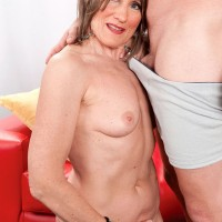 60+ MILF with great legs is relieved of her short dress and heels by younger lover