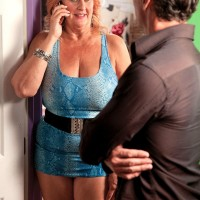 Busty granny blows a younger man's cock after seducing him in a short dress