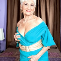 Over 60 lady with short hair exposes her lace underwear during a solo shoot