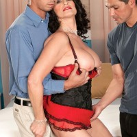 Over sixty pornstar Rita Daniels gives two cocks a handjob at same time