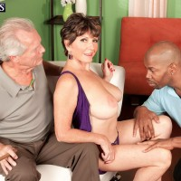 Beautiful 60 MILF is unzipped from a dress by a black bull in front of her cuckold
