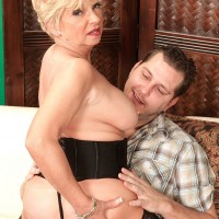 Sexy over 60 blonde meets her younger lover in sheer lingerie and nylons