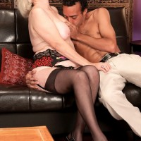 Nylon and garter clad 60+ MILF Lola Lee giving younger dick a blowjob