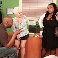 Over 60 blonde seduces a black man in her office when his wife walks in on them