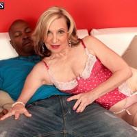 Lingerie and stocking adorned MILF 60 plus Miranda Torri riding BBC during interracial sex