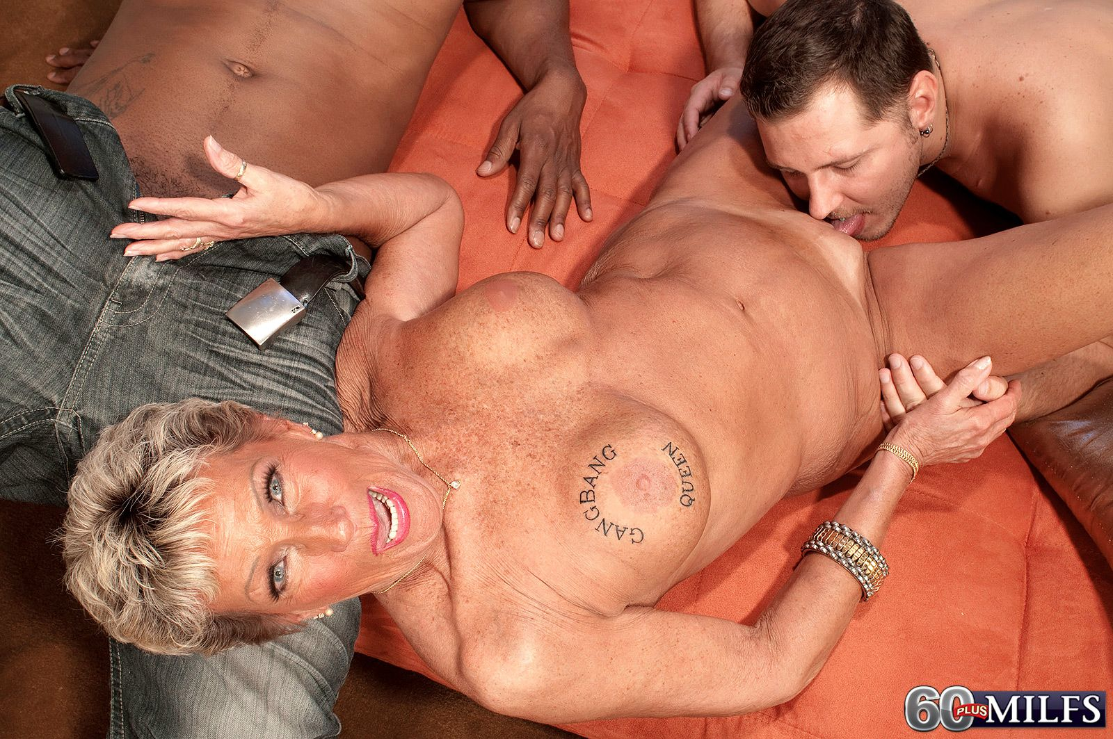 70 plus MILF Sandra Ann taking white and black cock in MMF threesome