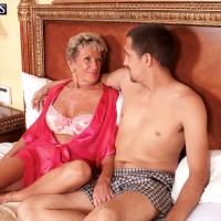 70 plus granny pornstar Sandra Ann fucking a younger stud in lingerie
