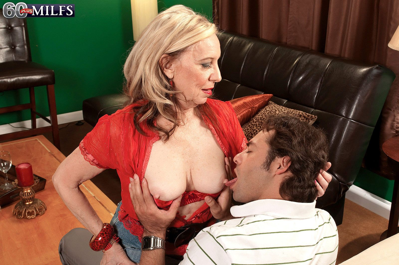 Sexy older blonde hikes up her skirt while seducing a younger gentleman