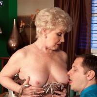 60 plus MILF Jewel seducing younger man in tan stockings and thong underwear