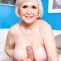 Busty short haired MILF 60 plus Lola Lee giving large cock a blowjob