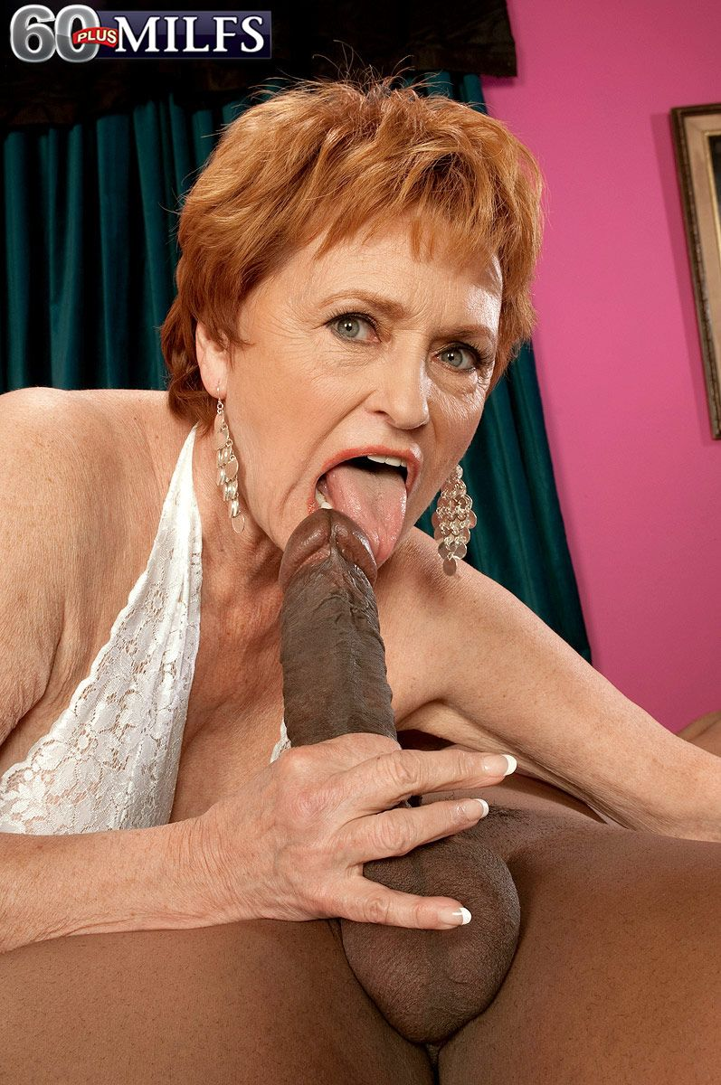 Over 60 lady with red hair goes down on a younger man's big black dick