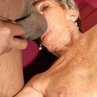 Over 70 GILF Sandra Ann sucks on a younger stud's big black dick like a trooper