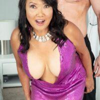60 plus Asian MILF Mandy Thai wears no boulder-holder under her dress while seducing a dude