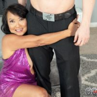 60 plus exotic MILF Mandy Thai wears no bra under her dress while putting the moves on a man
