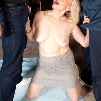 60 plus blonde grandmother Miranda Torri unsheathing giant aged breasts before MMF 3some