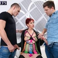 Sixty plus redhead Caroline Hamsel seduces a couple of dudes on the street in slutty clothes