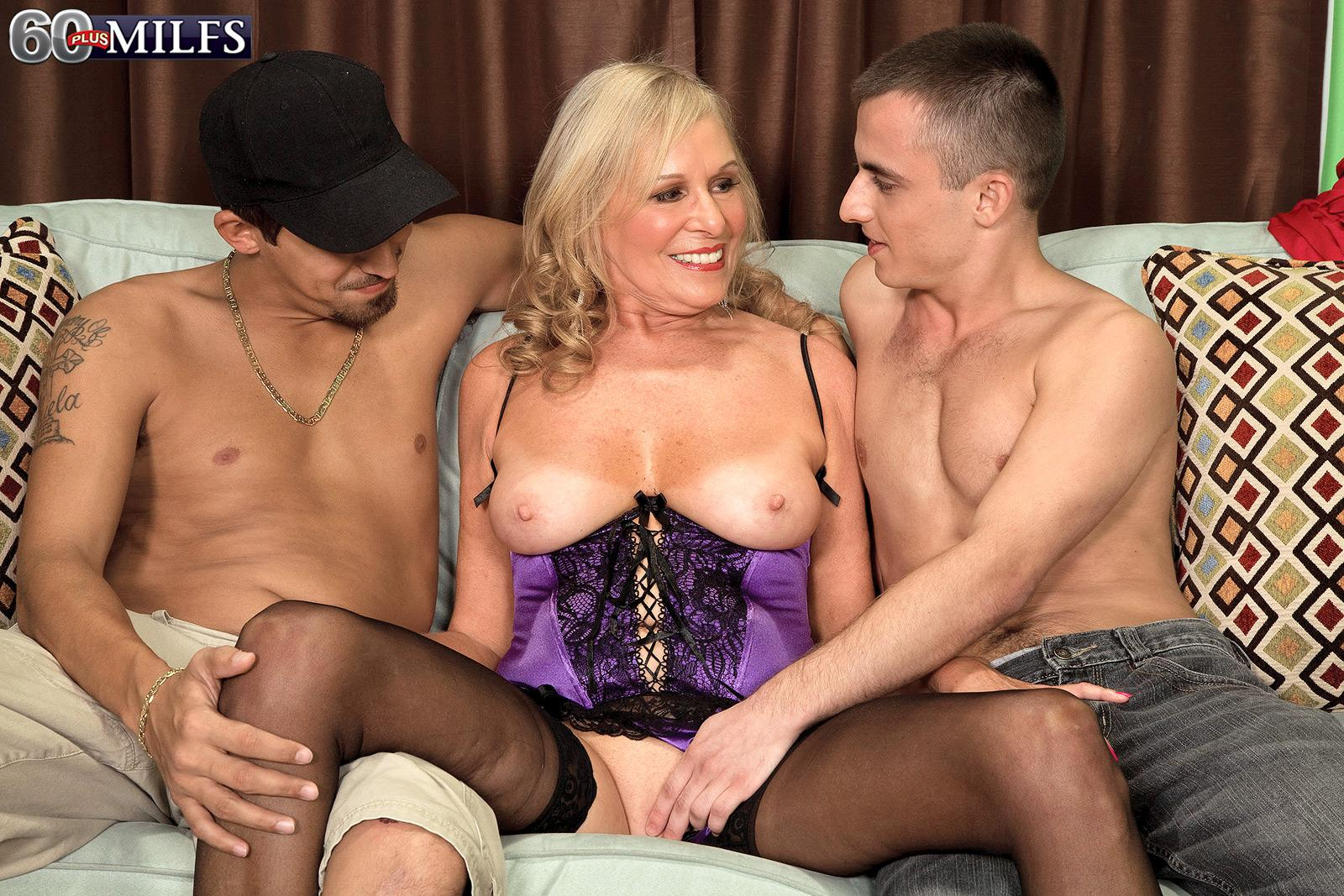 Aged sandy-haired XXX pornstar Bethany James jacking TWO boners in lingerie and hose