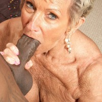 Big-boobed stocking and lingerie outfitted 70 plus grandma Sandra Ann delivering large black pecker a oral job