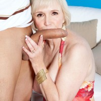 Big-chested short haired grandma Lola Lee delivering huge knob BJ and tit fucking in stockings