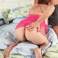 Big-titted red-haired grandma Bea Cummins jacking off huge dick while cuck husband sleeps