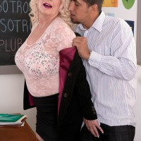Bosomy sandy-haired 60 plus MILF lecturer Angelique DuBois jacking monster-sized penis in classroom