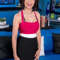 Chinese grandma Kim Anh is disrobed down to lingerie before unsheathing enormous mature titties