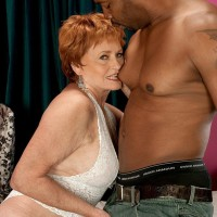 Crimson hair grannie adult movie star Valerie slurping off a huge ebony rod in milky lingerie