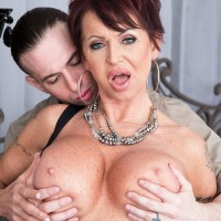 Elegant experienced woman Gina Milano tempts a junior man with her hefty melons