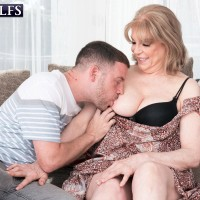 Experienced woman Crystal King has her massive titties played with by a junior man